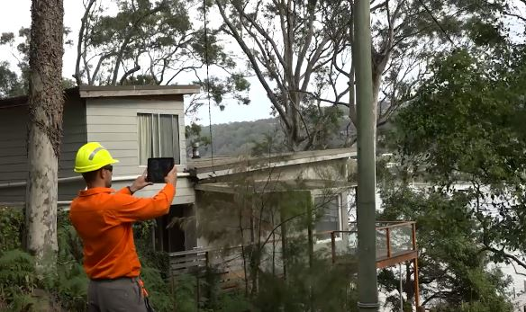 Ausgrid inspector checking private power poles for bushfire hazards